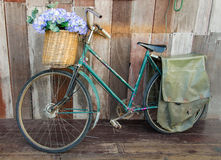 Old ladies bicycle leaning against a wooden plank Stock Photos
