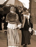 Old ladies dressed in vintage clothes with sepia effect Royalty Free Stock Images