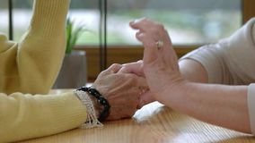 Old ladies holding hands. Discussion of two people. Be a supportive friend stock video footage