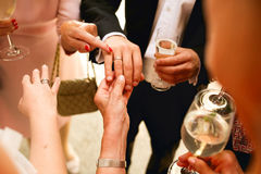 Old ladies look at newlyweds rings holding their hands.  Royalty Free Stock Photos
