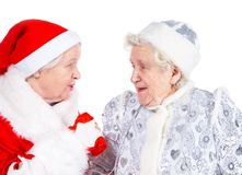Old Ladies- Snow Maiden and San. Old Ladies in the dress of the Snow Maiden and Santa Claus stock photo