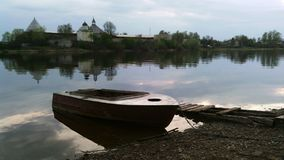 Old Ladoga Fortress. Boat on the water, on the background of Old Ladoga Fortress Stock Image