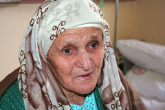 Old lady. Looking hopeless with her future Royalty Free Stock Images