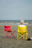 Old lady at beach. Old lday sitting in chair at beach Stock Images