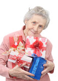 Old lady and boxes with gifts. On white background Stock Photography