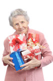 Old lady and boxes with gifts Royalty Free Stock Images