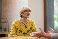 Old lady in cafe. Stock Images