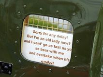 Old lady car overtake sign. Photo of a sign in old vintage gpo van warning of slow moving vehicle due to age Stock Photos
