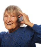 Old lady communicating through mobile phone Royalty Free Stock Image