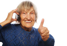 Old lady communicating through mobile phone Royalty Free Stock Photo