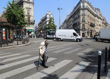Old lady crossing the road in Paris stock image