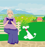 Old lady with dog in the park Royalty Free Stock Image