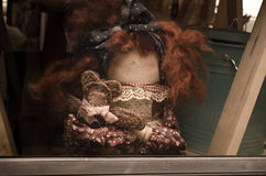 Old lady doll brown hair and several small dolls Royalty Free Stock Photo