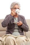 Old lady drinking coffee indoor Royalty Free Stock Images