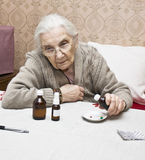 Old lady with medicines Stock Photography
