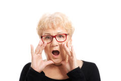 An old lady expresses shock/ surprise. Isolated on white royalty free stock image
