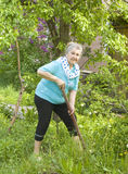 Old lady in garden Royalty Free Stock Images