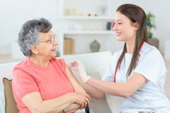 Old lady getting injection at home Royalty Free Stock Images