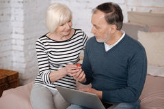 Old lady giving some remedy to man Royalty Free Stock Photo