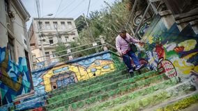 Old lady going down the colorful stairs of valparaiso, chile stock photography