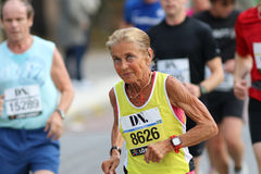 Old lady in good shape running Stock Photos