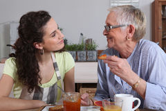 Old lady and grandaughter eating Stock Photos