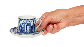 Old lady (hand) with an antique Dutch cup in Delfts blue, Holland stock images