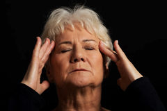 An old lady having a headache. Stock Photo