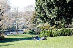 Old lady has rest in a park in York in 2018. Old lady is having rest in an English park in York in sunny afternoon in February 2018 stock photography