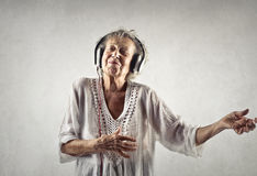 Old lady with headset Royalty Free Stock Images