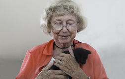Old Lady and Her Beloved Kitty Royalty Free Stock Photography