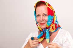Old Lady with her Head Scarf stock image