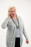 Old lady holding cell phone. Royalty Free Stock Photo