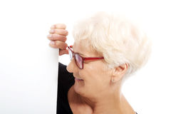 An old lady holding copy space. Royalty Free Stock Images