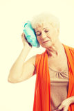 An old lady with ice bag by her head. Royalty Free Stock Image