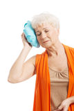An old lady with ice bag by her head. Stock Photography