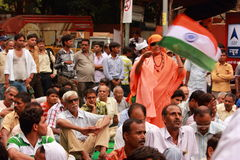 Old lady with Indian flag in crowd in India Royalty Free Stock Images