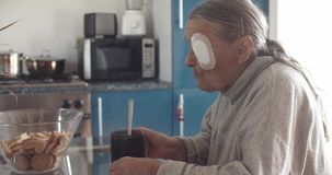Old Lady with injured eye drink tea at kitchen.  stock video