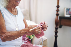 Old lady knitting Royalty Free Stock Photo