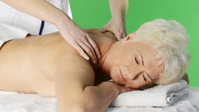 An old lady lying at spa salon. stock video footage