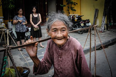 Old Lady At The Market. An old lady selling fruit at the market in Hoi An, Vietnam Royalty Free Stock Photos
