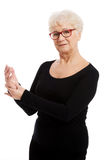 An old lady massaging her hands/ palms. Stock Image