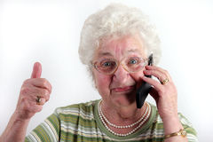 Old lady with mobile phone Stock Images