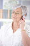 Old lady on mobile phone Stock Image