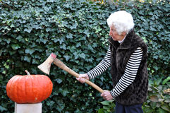 Old lady modelling a pumpkin Royalty Free Stock Photography