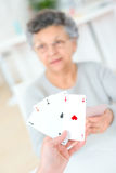 Old lady playing card game Stock Photos