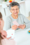 Old lady playing card game Royalty Free Stock Images