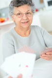 Old lady playing card game Royalty Free Stock Photo