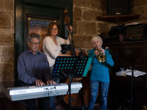 Old lady playing trumpet in a band. A 90 year old musician plays trumpet with a band in an old pub in the Rocks, Sydney Royalty Free Stock Photo
