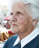 Old lady portrait. Portrait of an old lady with wrinkles and sun stained skin and white hair Royalty Free Stock Photos